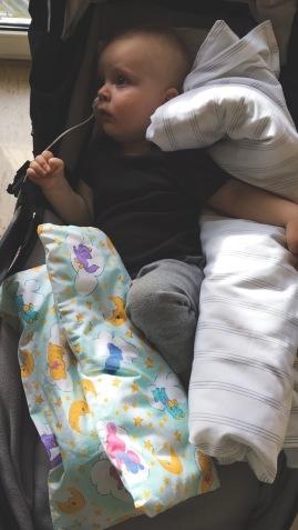 """""""nesting"""" in his stroller."""